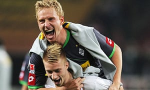 Marco Reus carries striker Mike Hanke after Gladbach's latest victory