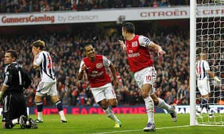 Arsenal's Robin van Persie, right, celebrates scoring the opening goal against West Bromwich Albion.