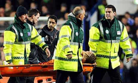 Lucas Leiva of Liverpool is carried off after damaging a knee ligament at Chelsea