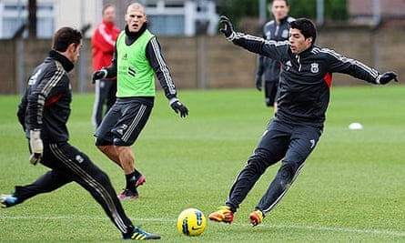 Luis Suárez in training with Liverpool on the day he was banned for racially abusing Patrice Evra