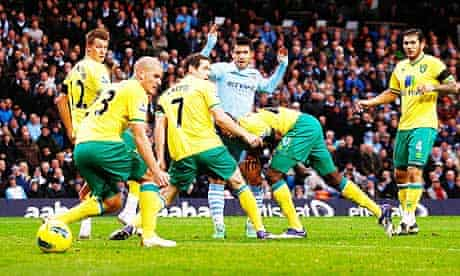 Sergio Aguero scores Manchester City's first goal against Norwich City