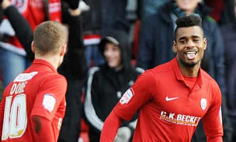 Barnsley's Ricardo Vaz Te celebrates the first of his goals against Leeds United with Matt Done