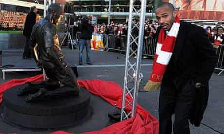 Thierry Henry poses next to a statue of himself