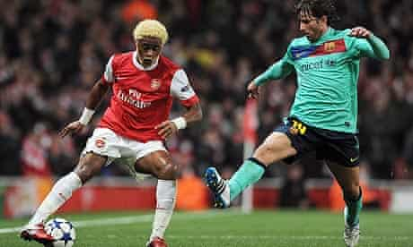 Arsenal's Alex Song and Barcelona's Lionel Messi
