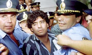 Diego Maradona leaves a courthouse after answering charges he shot and injured journalists