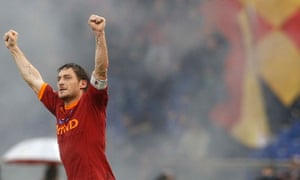 Roma's Francesco Totti celebrates after scoring against Lazio