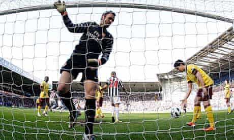 Arsenal pick the ball out of their net