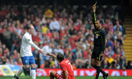 England's Wayne Rooney is booked during the qualifier against Wales in Cardiff on Saturday.