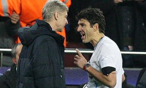Arsenal's Manager Arsene Wenger argues with referee Massimo Busacca