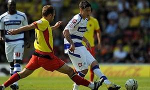 QPR's Alejandro Faurlín plays a pass ahead of Watford's John Eustace