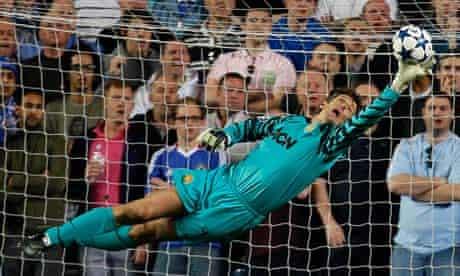 Manchester United's goalkeeper Edwin van der Sar saves from Chelsea's Fernando Torres
