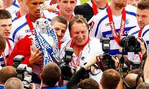 Neil Warnock celebrates with QPR players after winning the Championship