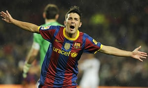 David Villa celebrates after scoring during Barcelona's 5-0 win over Real Madrid in November