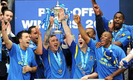 AFC Wimbledon's Danny Kedwell lifts the play-off trophy