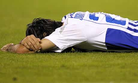 Deportivo midfielder Juan Rodriguez lies on the pitch at the end of the 1-0 defeat to Valencia