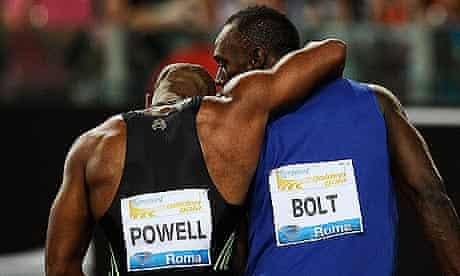 Usain Bolt, right, celebrates with Jamaican compatriot Asafa Powell after the 100m in Rome