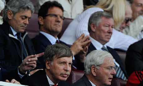 Stan Kroenke, bottom left, in front of Fabio Capello and Sir Alex Ferguson at Arsenal