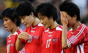 North Korean players leave the field after their 2-0 defeat to the USA