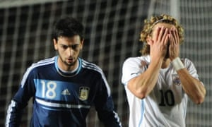 Diego Forlan reacts to Javier Pastore