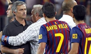 José Mourinho is restrained by a Barcelona offical during the aftermath of Marcelo's tackle