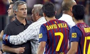 Real Madrid's José Mourinho is restrained