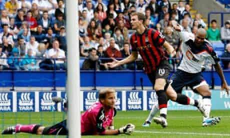 Manchester City's Edin Dzeko celebrates scoring what proved the decisive goal at Bolton Wanderers