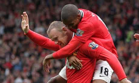 Wayne Rooney and Ashley Young celebrate
