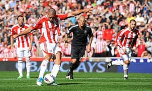Stoke City's Jonathan Walters puts his side 1-0 up against Liverpool with a penalty