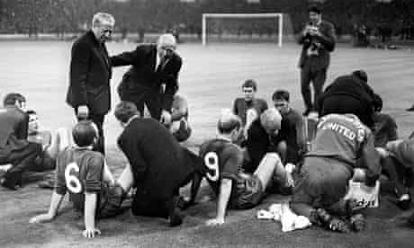 Sir Matt Busby talks to his Manchester United players