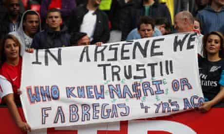 Arsenal fans with a banner in support of manager Arsène Wenger