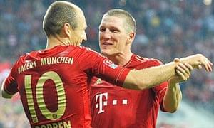 Arjen Robben and Bastian Schweinsteiger celebrate