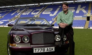 Sir John Madejski on the Reading pitch with his car.