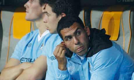 Manchester City's Carlos Tevez sitting on the bench