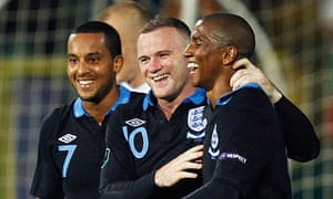 Arsenal's Theo Walcott with Ashley Young and Wayne Rooney in Bulgaria