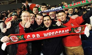 Wrexham supporters celebrate after the 1-1 draw at Brighton in the FA Cup third round