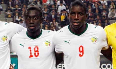 Papiss Demba Cisse and Demba Ba stand together for a team photo with Senegal