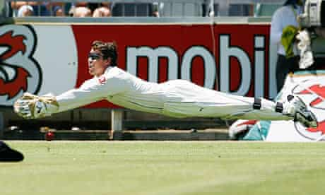 England's Jones drops a catch from Australia's Hussey