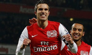 Robin van Persie celebrates scoring his second goal