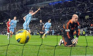Manchester City's James Milner celebrates scoring his side's penalty past Liverpool's Pepe Reina