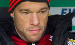 Michael Ballack sits on the bench