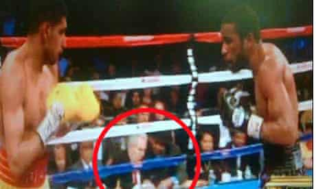 Amir Khan has questioned the presence of a mystery man in a hat at his defeat to Lamont Peteerson.