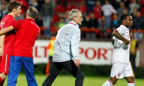 Serbian player Milos Ninkovic, left, and England's Danny Rose
