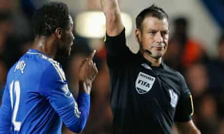 Mark Clattenburg shows Mikel Jon Obi a yellow card during Manchester United's 3-2 win at Chelsea