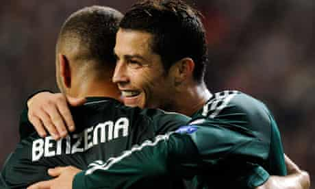 Real Madrid's Cristiano Ronaldo and Karim Benzema celebrate during the win at Ajax