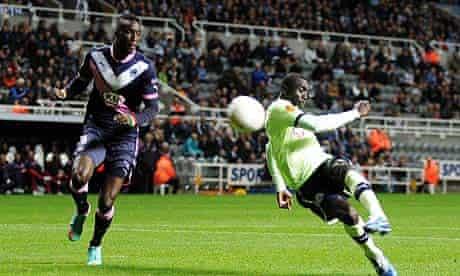 Papis Cissé, right, connects to score Newcastle's third