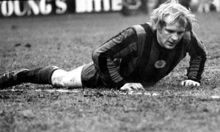 Francis Lee lying on the pitch during a game between Crystal Palace and Manchester City in 1972