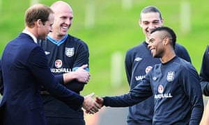 The Duke of Cambridge shares a joke with Ashley Cole