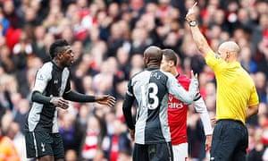 Tottenham Hotspur's Emmanuel Adebayor sent off by Howard Webb for a foul on Arsenal's Santi Cazorla