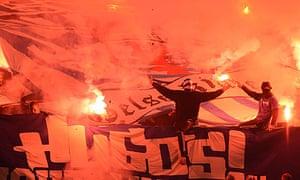 Schalke ultras light flares ahead of the second half against Frankfurt