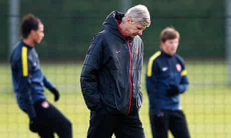 Arsenal manager Arsene Wenger attends a team training session in London Colney